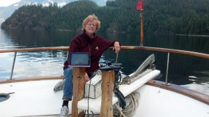 Linda with iPad on boat